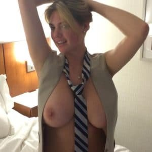 Leaked pic of Kate Upton with tits out and a tie around her neck wearing a tan vest