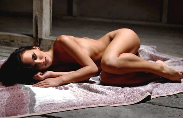 the artist Natalie Portman laying nude on a blanket