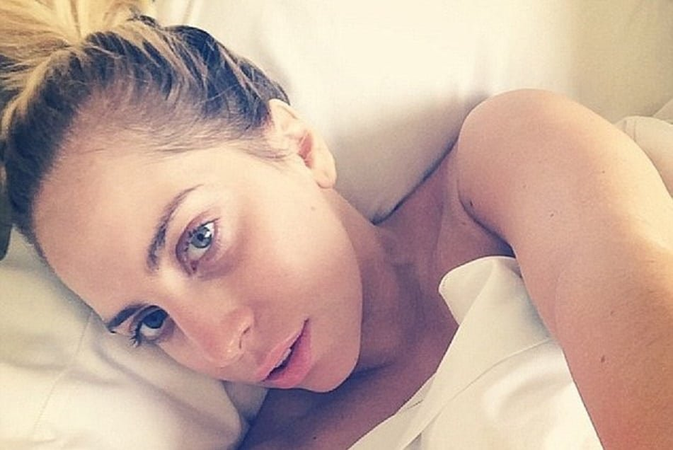 The sensual Lady Gaga taking a selfie in bed