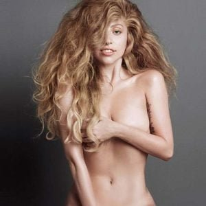 The fantastic Lady Gaga with big hair and arms over breasts