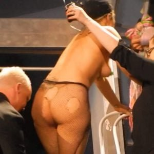 The scandalous Lady Gaga in fishnets showing her bare ass