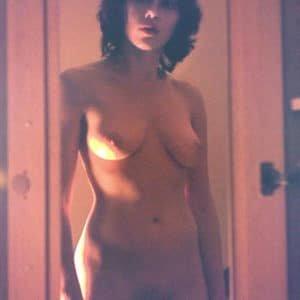 The dazzling Scarlett Johansson standing in a door way completely nude