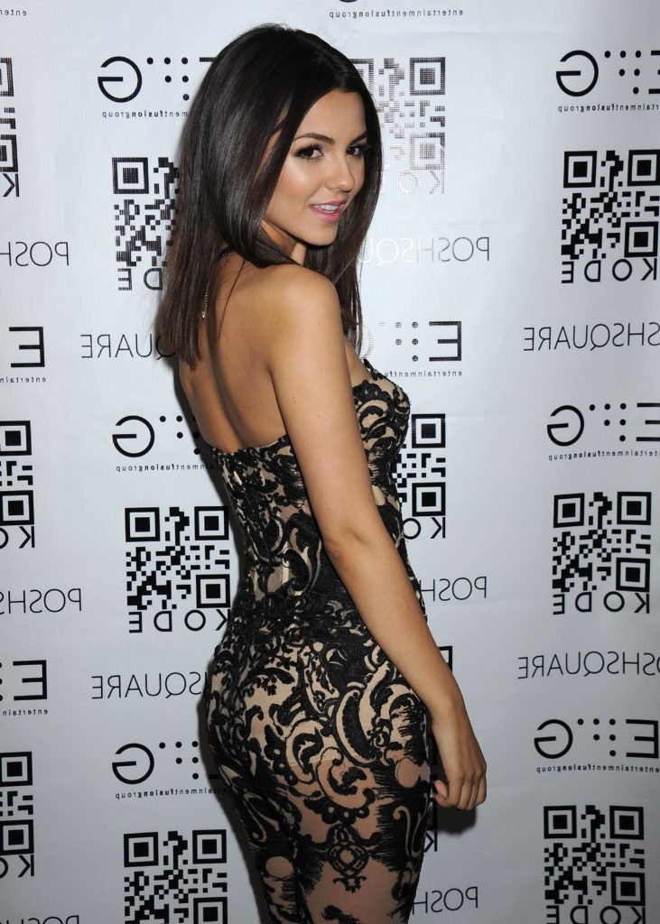 The celeb Victoria Justice in nude and black dress showing underwear