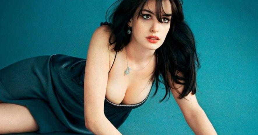 Actress Anne Hathaway on the floor modeling in a dress showing her boobs off