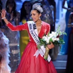 Beauty queen Olivia Culpo in Miss Universe competition with a red gown on
