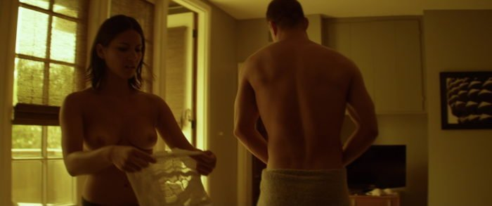 Channing Tatum shirtless and topless Olivia Munn putting on a shirt in movie scene