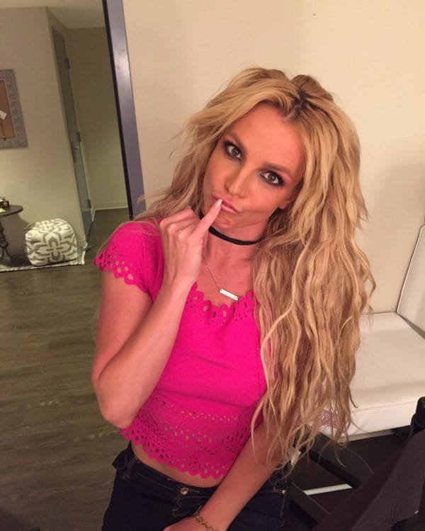 Britney Spears in hot pink shirt making a funny face