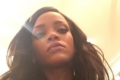 Rihanna taking a selfie with long hair