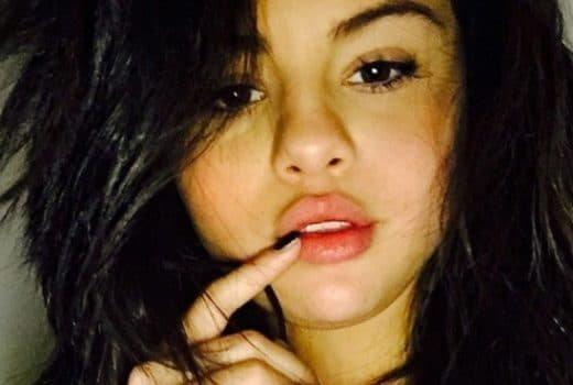 Selena Gomez selfie with finger on her lip looking hot