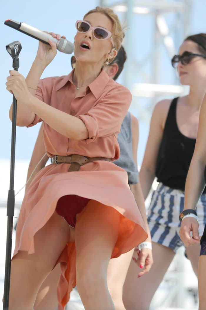 Singer Kylie Minogue shows her panties in upskirt photo weraing pink outfit