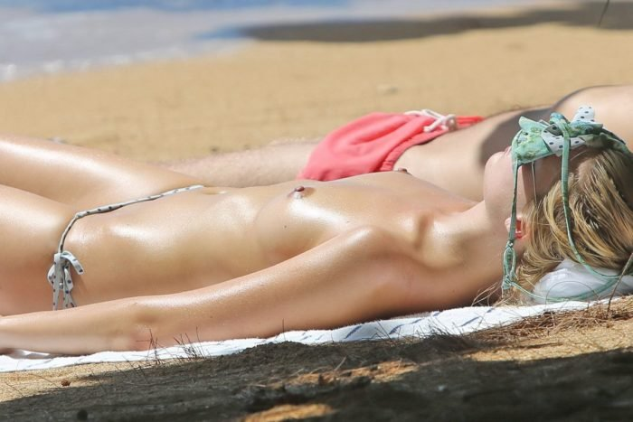 Up close pic of Margot Robbie sunbathing topless