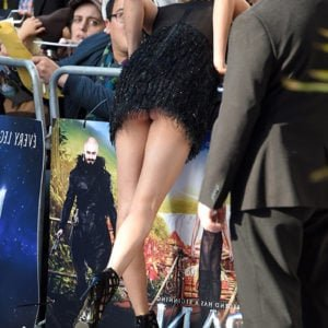 Upskirt and booty cheek flash of Cara Delevingne at Pan premiere in London