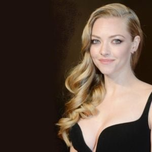 blonde star amanda seyfried in black dress showing off cleavage