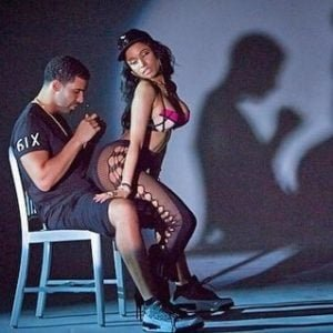 photo of Drake staring at Nicki Minaj's booty while he is getting a lap dance from her