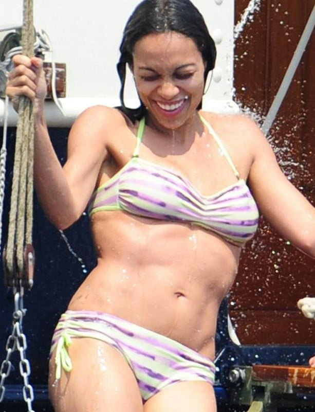 Rosario Dawson wet in bikini smiling and showing off her abs