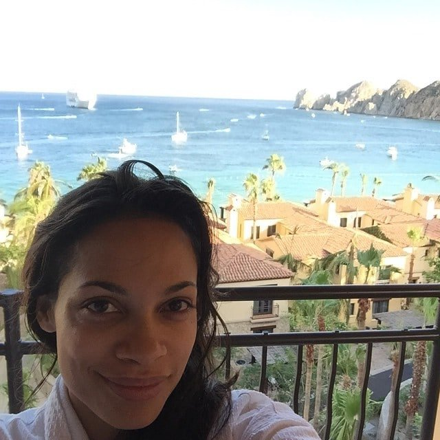 rosorio dawson takes a selfie with ocaean view behind her and wearing no make up