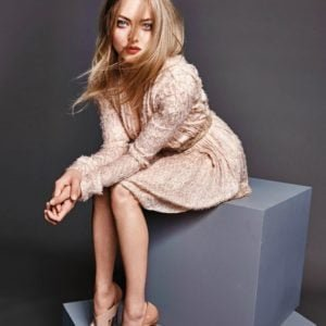 thomas nutzl photo of amanda seyfried sitting in a pink dress with hair in her face
