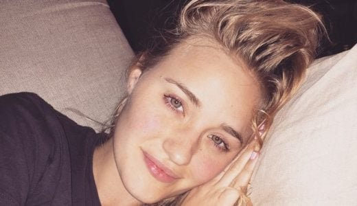 AJ Michalka selfie laying on a pillow