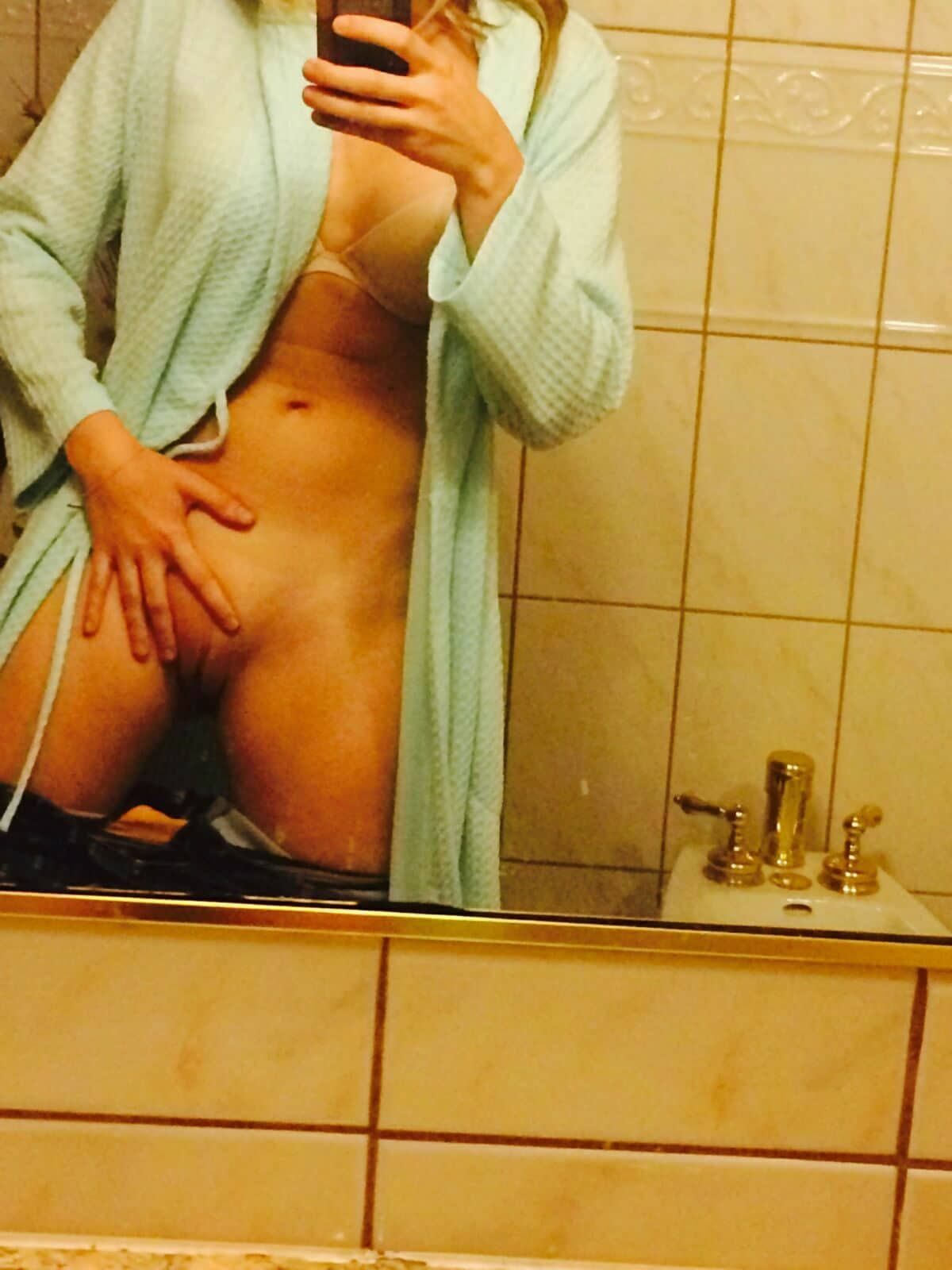 AJ Michalka taking a bathroom selfie in a blue robe with no panties on