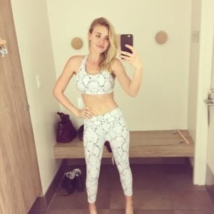 AJ Michalka taking selfie in yoga outfit