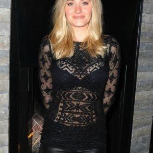 AJ Michalka wearing a black sheer lace top