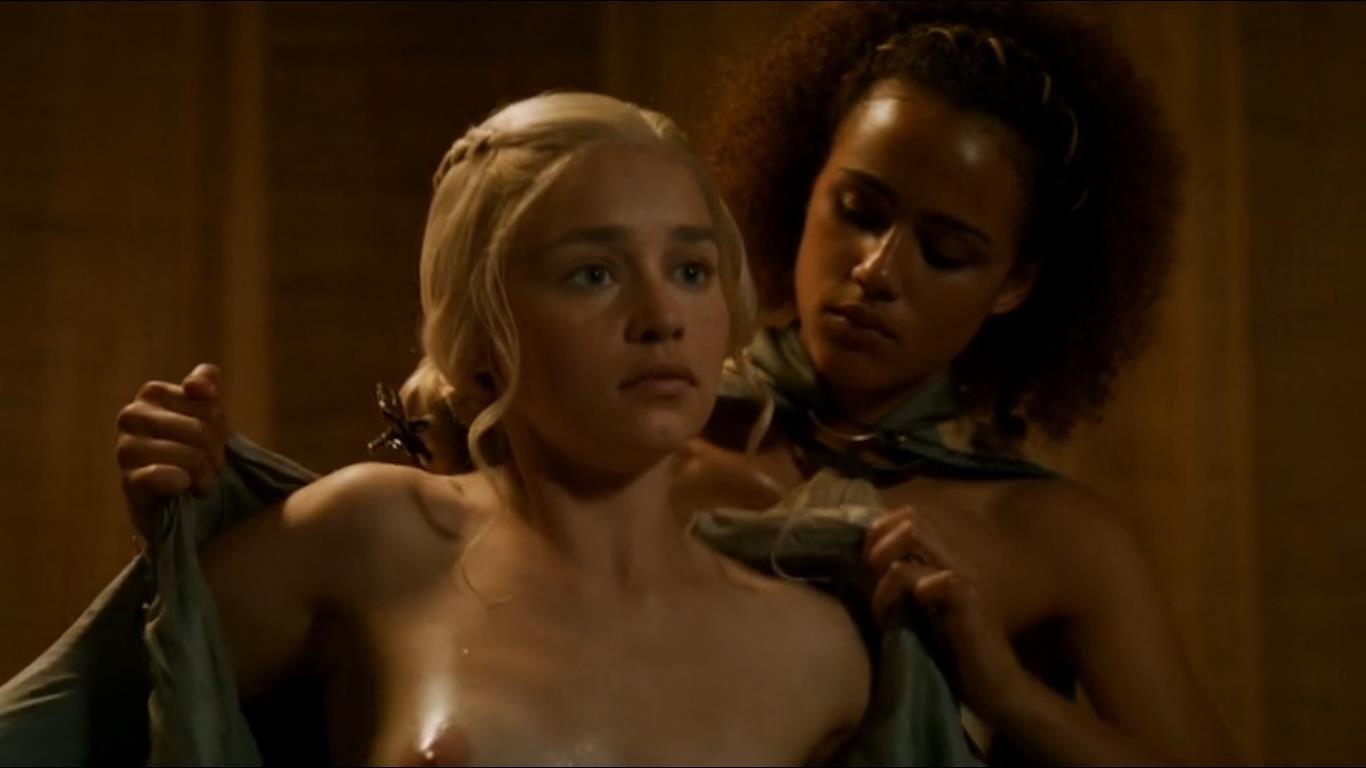 Emilia Clarke putting robe on exposing nipples