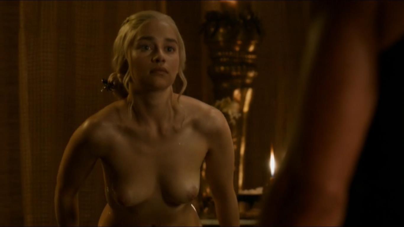 Emilia Clarke topless bending forward