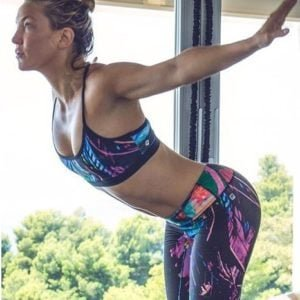 Kate Hudson doing yoga in colorful top and pants