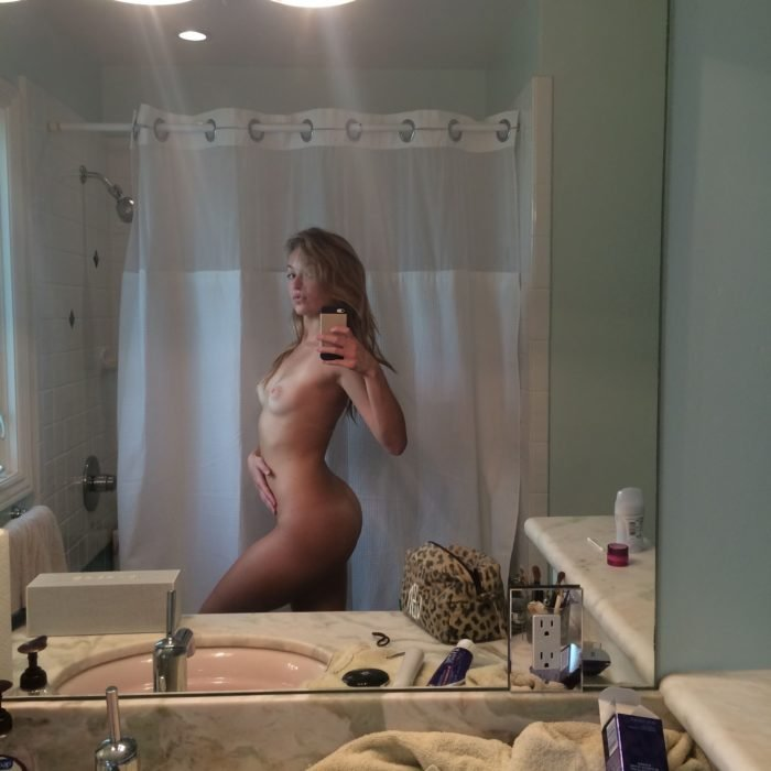 Lili Simmons totally nude selfie with hand on her stomach