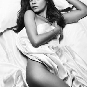 Mila Kunis completely nude wrapped in white sheets