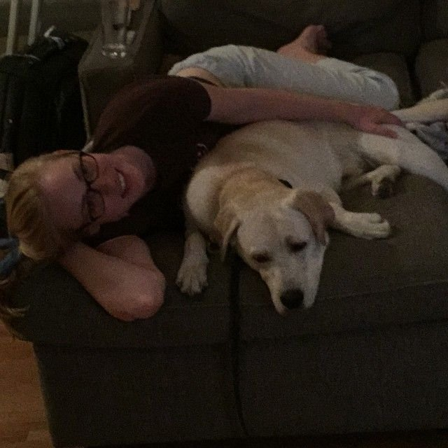 Deborah Ann Woll cuddeling with dog