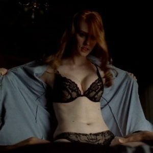 Deborah Ann Woll taking her shirt off