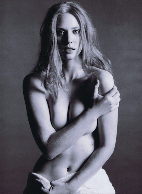 Deborah Ann Woll topless arms covering her tits