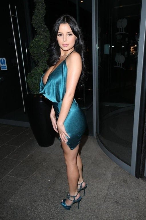 Demi Rose Mawby in blue sheen dress suffers a nip slip
