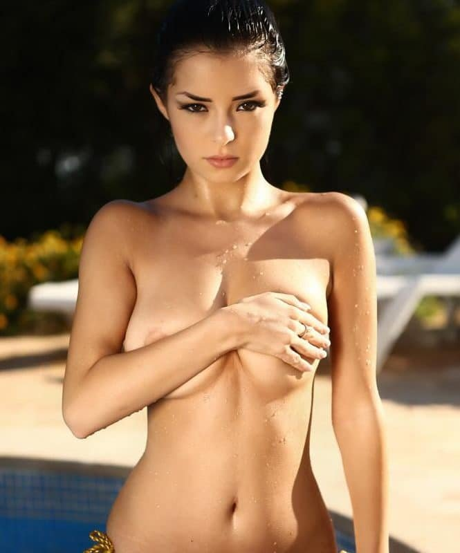 Demi Rose Mawby suffers nip slip while modeling topless