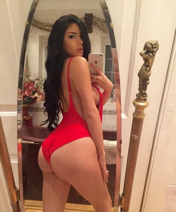 Demi Rose in a red swimsuit sticking ass out