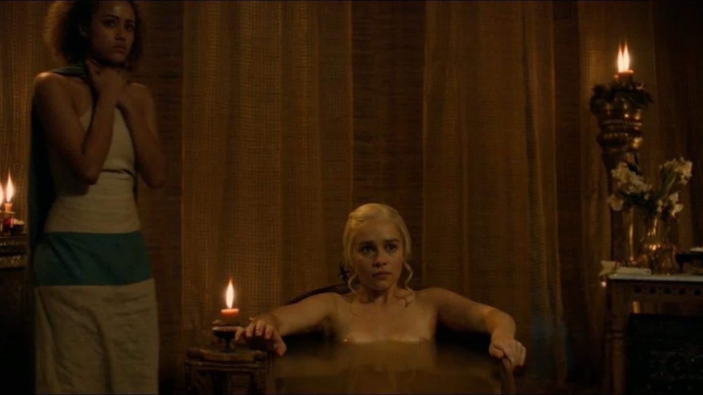 Emilia Clarke in a bathtub boobs above water