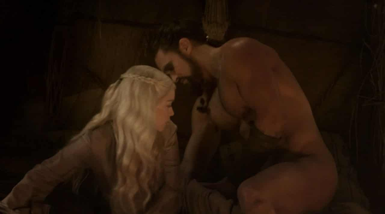 Emilia Clarke in a robe naked man next to her side