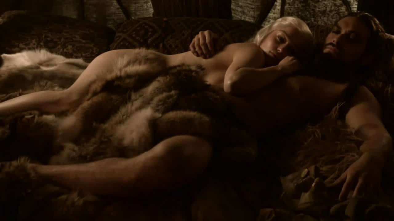 Emilia Clarke laying down next to man in the nude fur covering her pussy