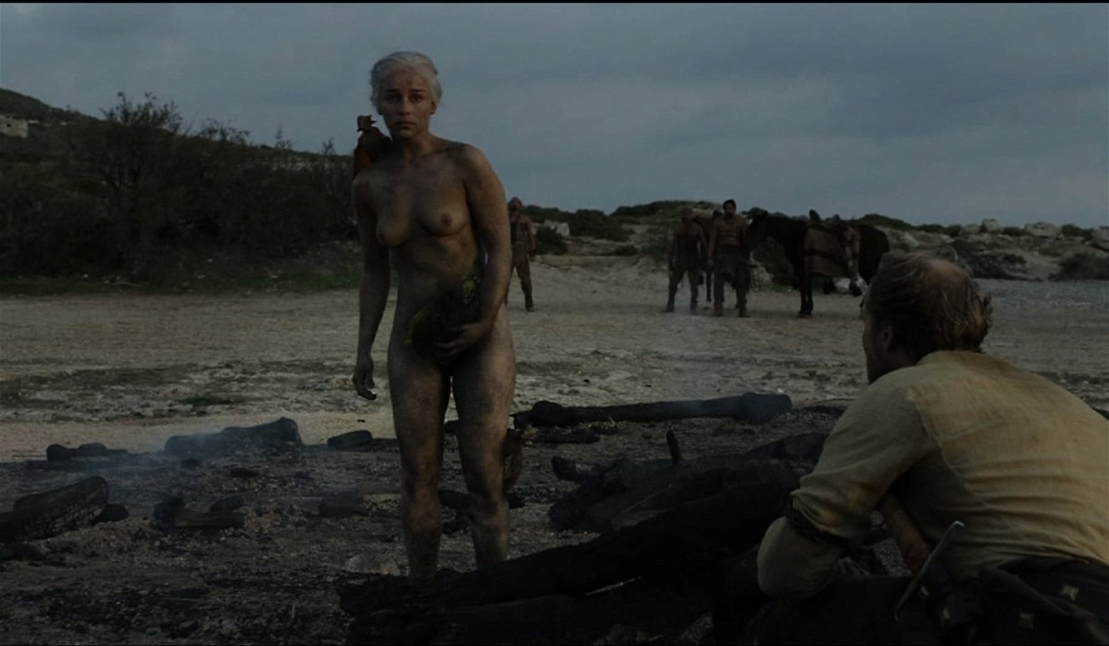 Emilia Clarke standing in the nude covered in ash