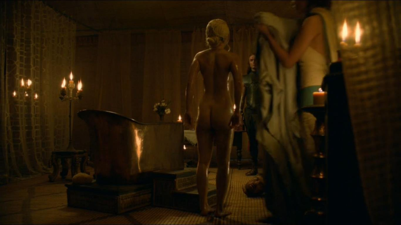 Emilia Clarke standing next to bath tube in the nude