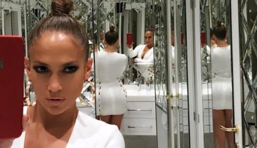 Jennifer Lopez taking a selfie in a room of mirrors