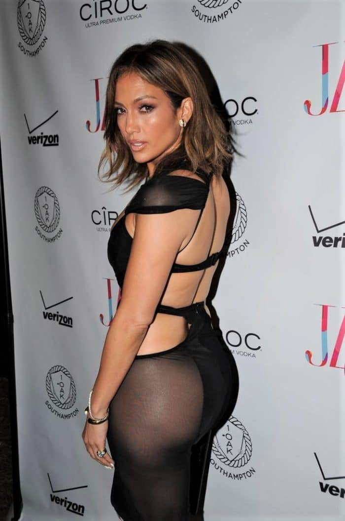 Jennifer Lopez wearing a tight cut out black dress on her 46th bday