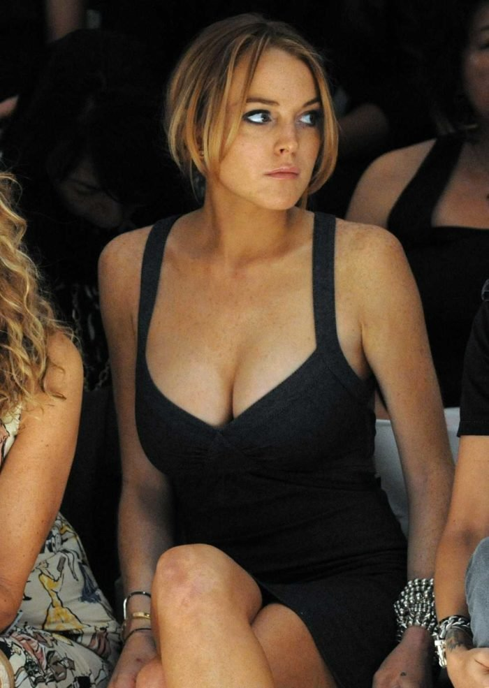 Lindsay Lohan in a black dress nice cleavage