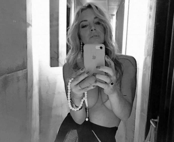 Lindsay Lohan selfie with pearls and no top
