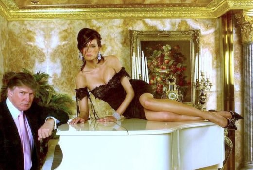 Melania Trump laying on a white piano with Donald Trump