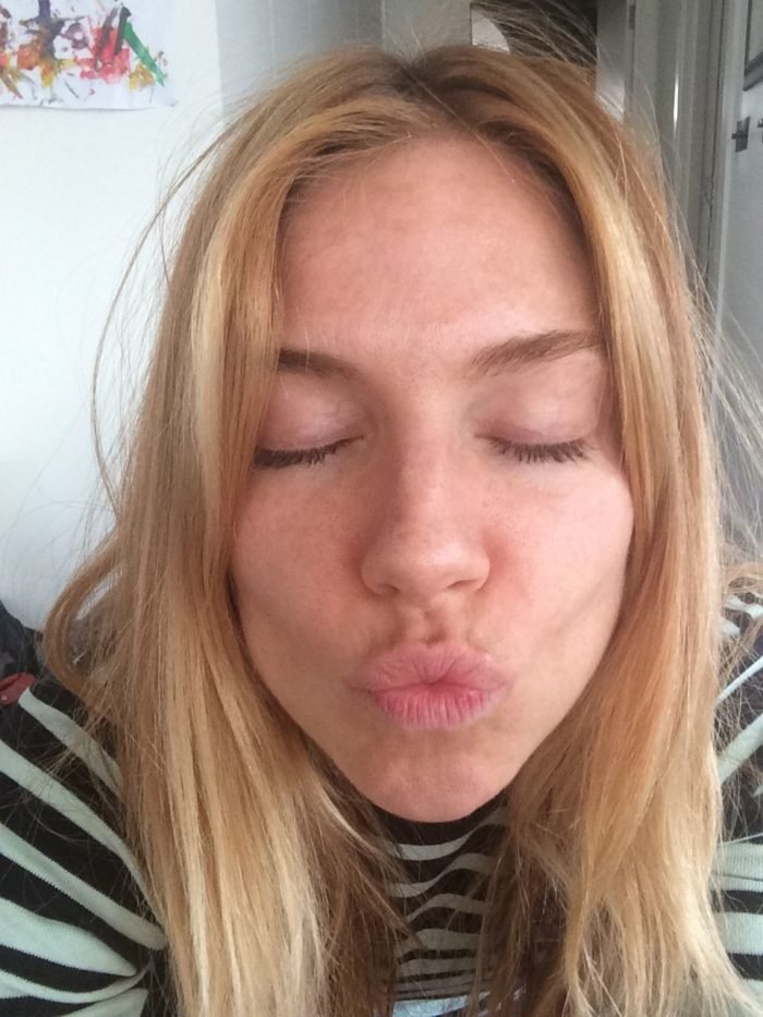 Sienna Miller making a kissing face as she takes a selfie