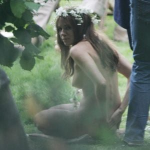 Sienna Miller with brown hair in the movie Hippie Hippie Shake and tits visible