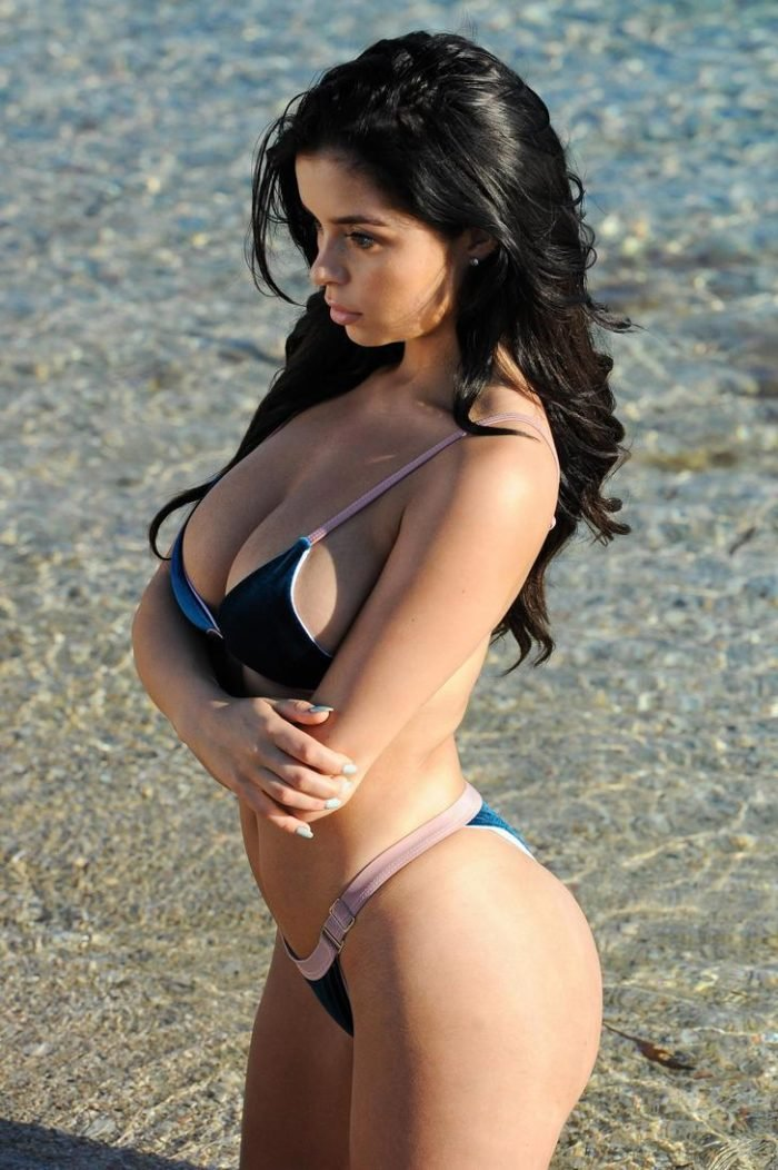 Demi Mawby modeling on the beach showing her big boobs off