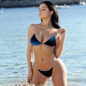 Demi Rose modeling in the ocean off of Ibiza